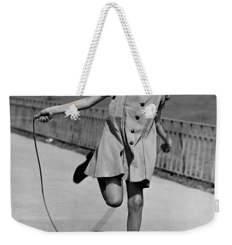 Child Weekender Tote Bag featuring the photograph Girl Jumping Rope by George Marks