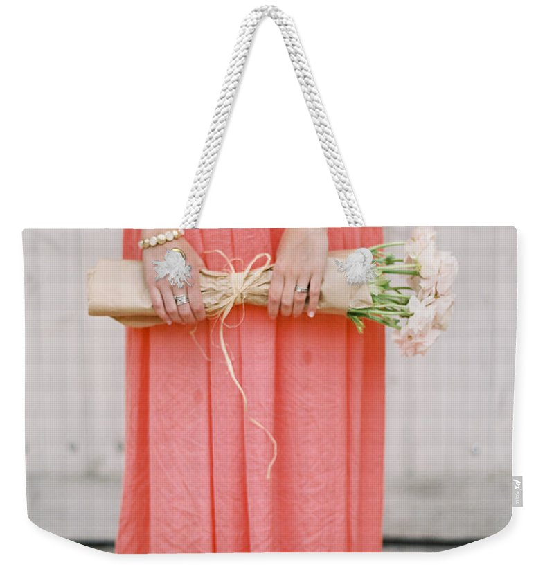 People Weekender Tote Bag featuring the photograph Girl With Flowers by Photographed By Victoria Phipps ©