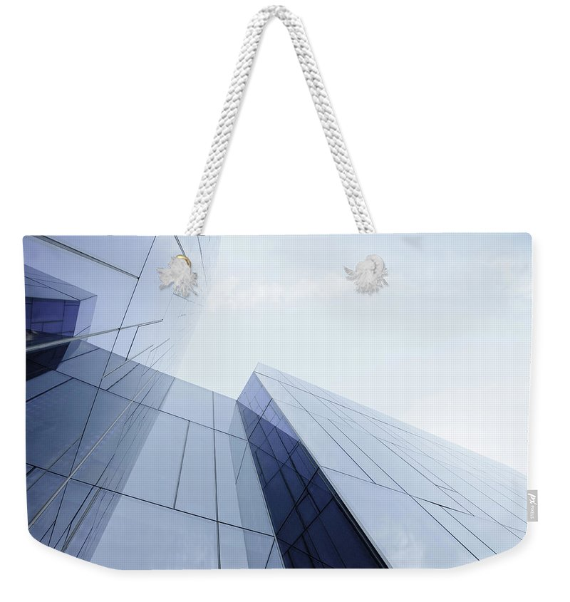 Architectural Feature Weekender Tote Bag featuring the photograph Glass And Steel Office Building by Crossbrain66