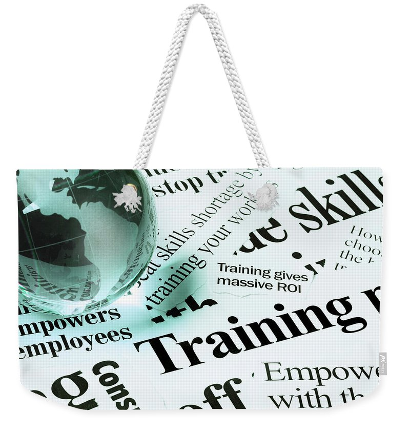 Employment And Labor Weekender Tote Bag featuring the photograph Glass Globe Paperweight On Headlines by Rapideye