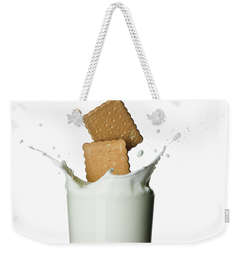 Milk Weekender Tote Bag featuring the photograph Glass Of Milk by Buena Vista Images