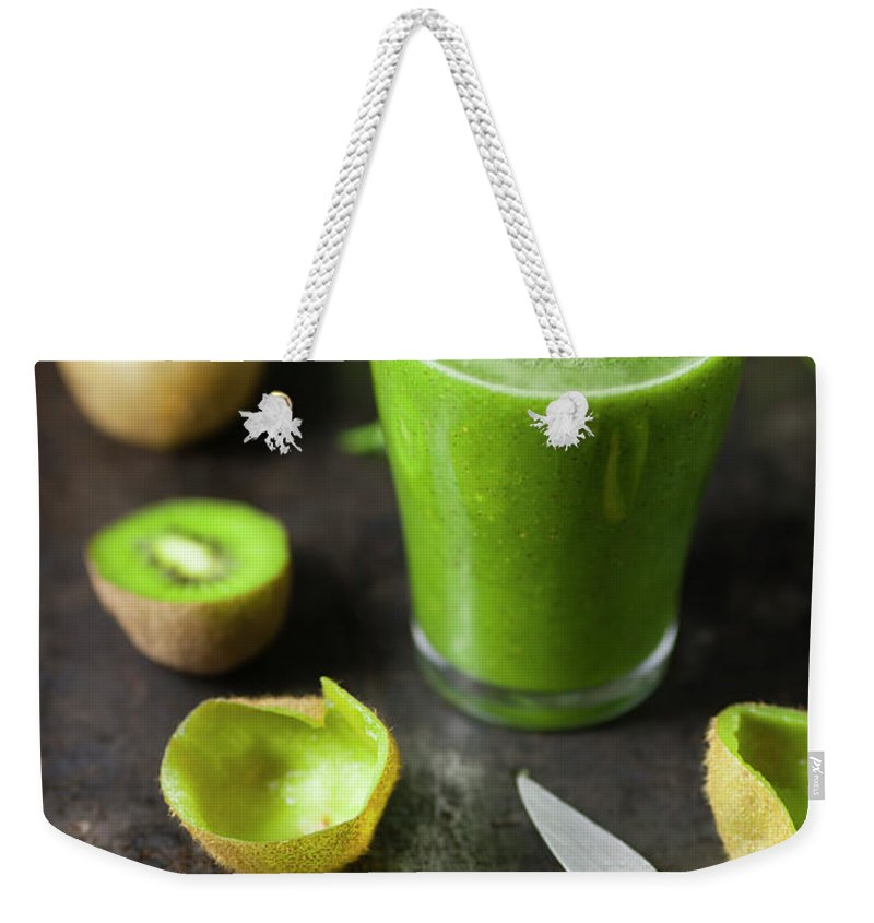 Cutting Board Weekender Tote Bag featuring the photograph Glass Of Smoothie With Kiwi, Parsley by Westend61