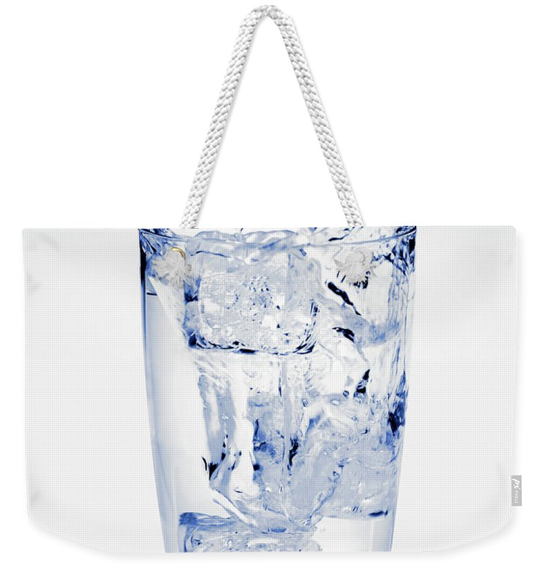 White Background Weekender Tote Bag featuring the photograph Glass Of Water Splashing Around by Maria Toutoudaki