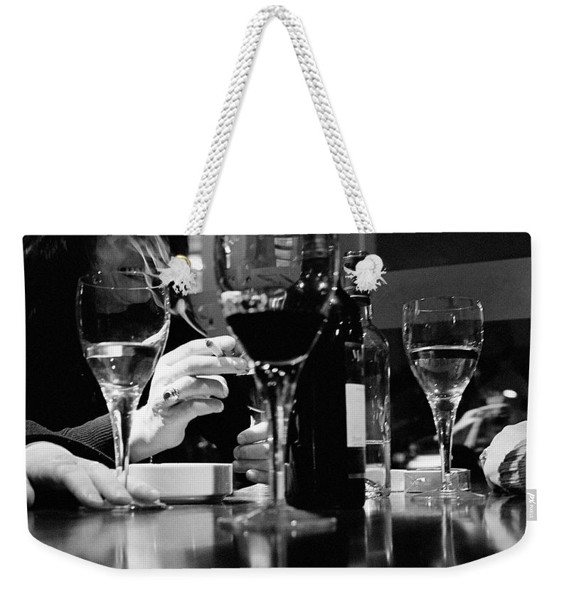 Smoking Weekender Tote Bag featuring the photograph Glasses Of Wine by Matt Carr