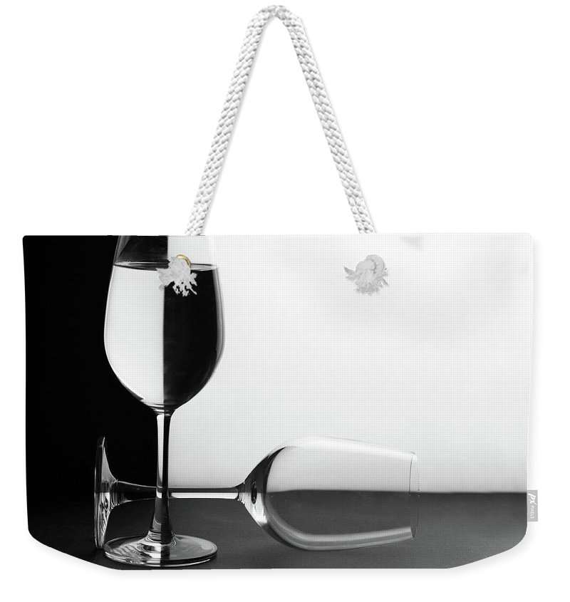 Alcohol Weekender Tote Bag featuring the photograph Glasses by Photo By Bhaskar Dutta