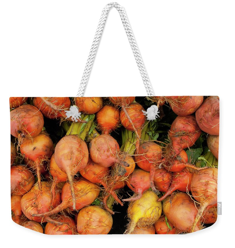 Orange Color Weekender Tote Bag featuring the photograph Golden Beets At A Farmers Market by Bill Boch