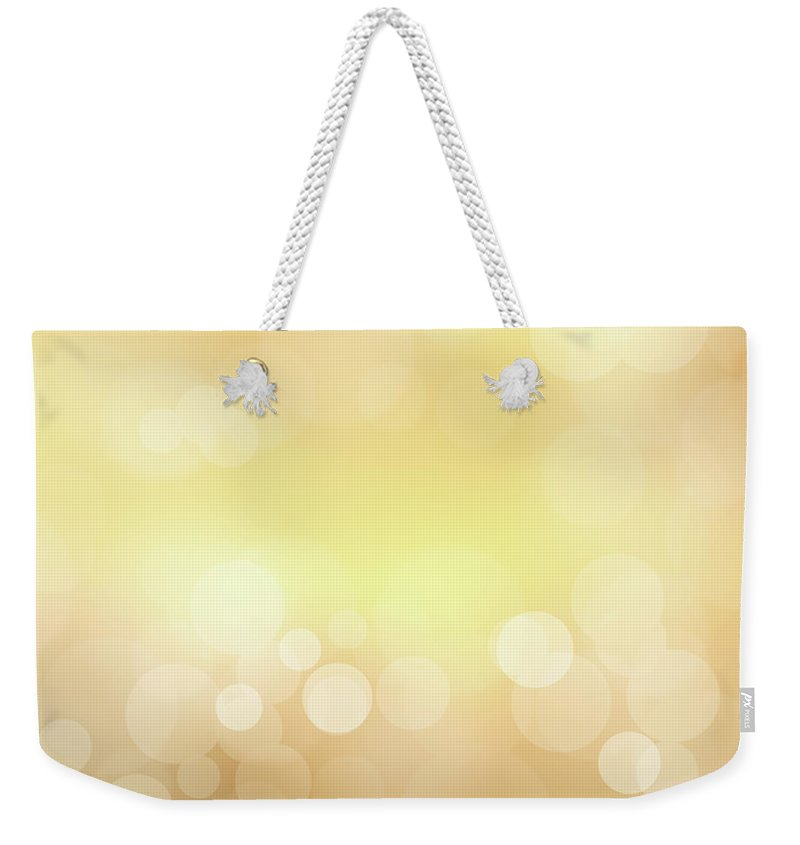 Backdrop Weekender Tote Bag featuring the photograph Golden Glitter by Kwaigon