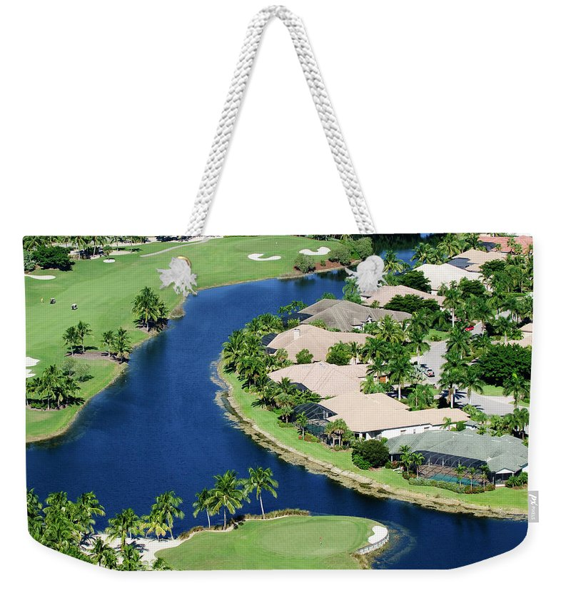 Recreational Pursuit Weekender Tote Bag featuring the photograph Golf Course Community by Negaprion