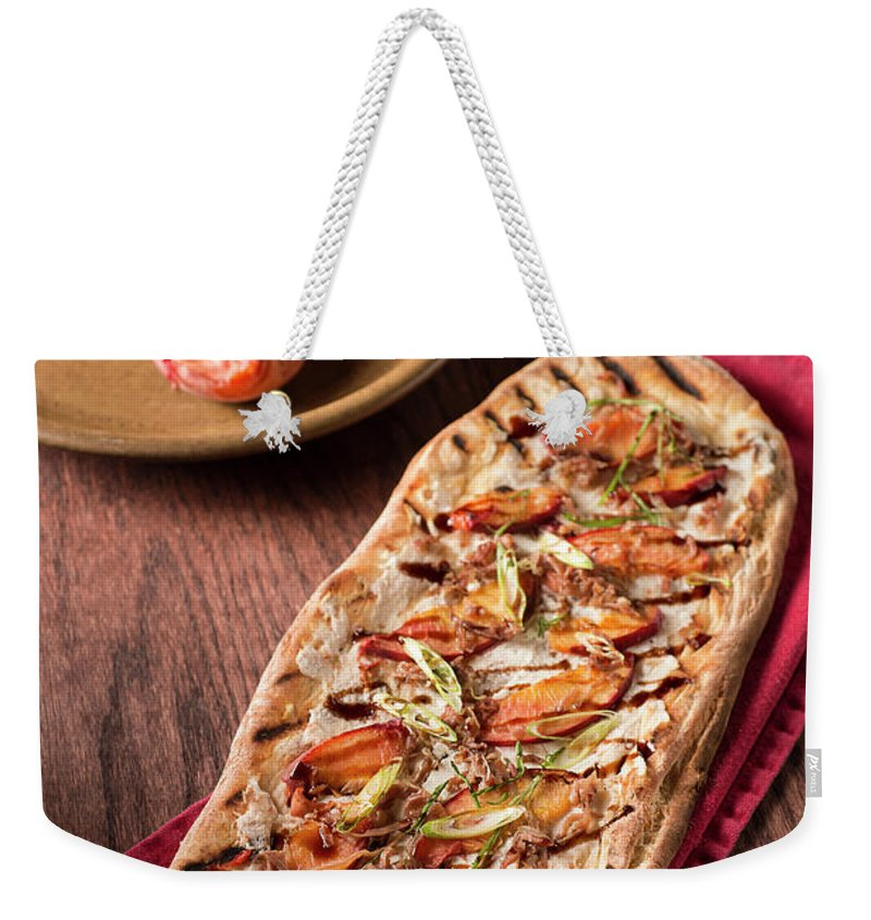 Cheese Weekender Tote Bag featuring the photograph Gourmet Pizza by Rudisill