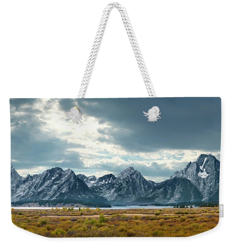 Scenics Weekender Tote Bag featuring the photograph Grand Tetons In Dramatic Light by Ed Freeman