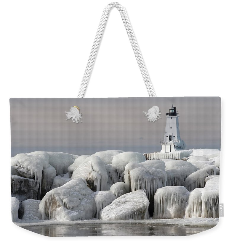 Water's Edge Weekender Tote Bag featuring the photograph Great Lakes Lighthouse With Ice Covered by Jskiba