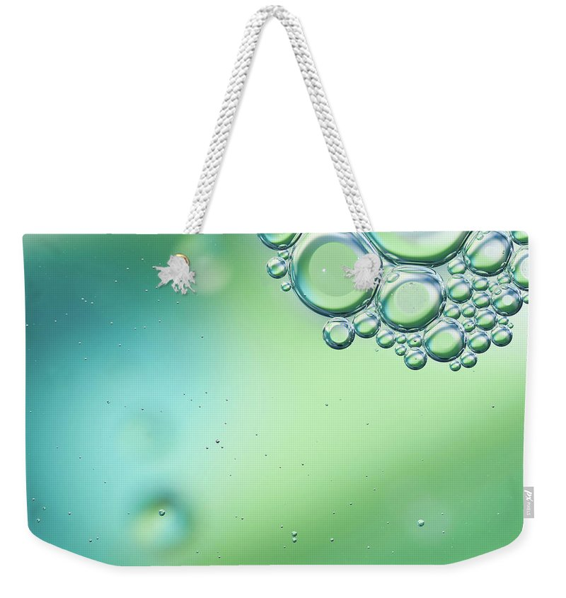 Art Weekender Tote Bag featuring the photograph Green And Blue Bubbles Background by Martin Wahlborg