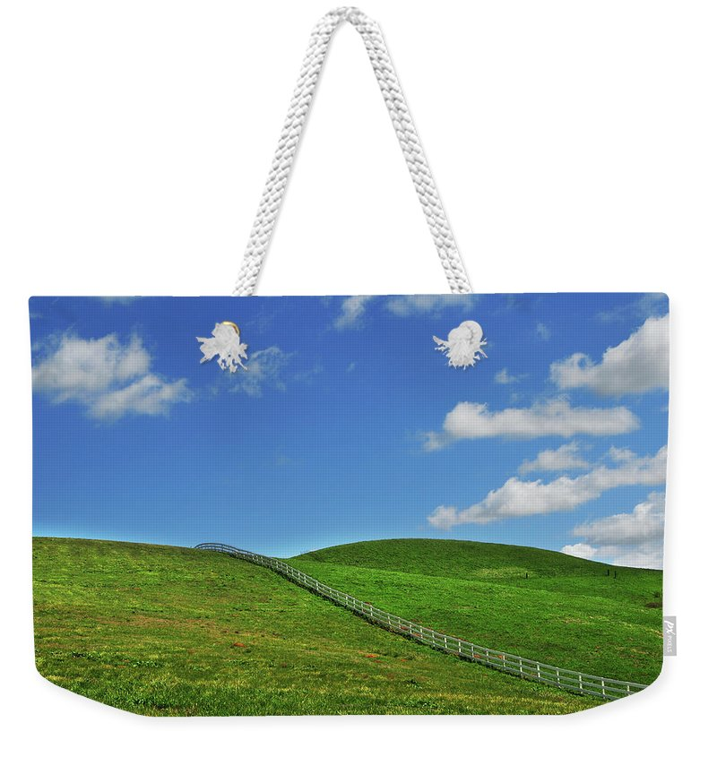 Scenics Weekender Tote Bag featuring the photograph Green Hills And Fence by Mitch Diamond