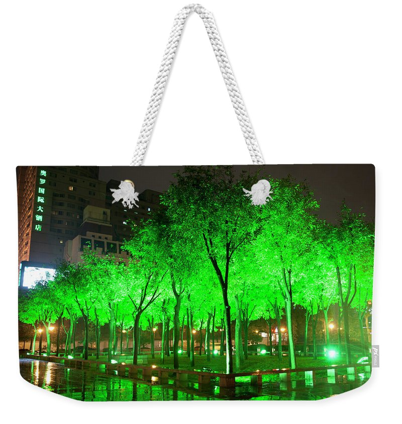 Outdoors Weekender Tote Bag featuring the photograph Green Illuminated Trees, China by Shanna Baker