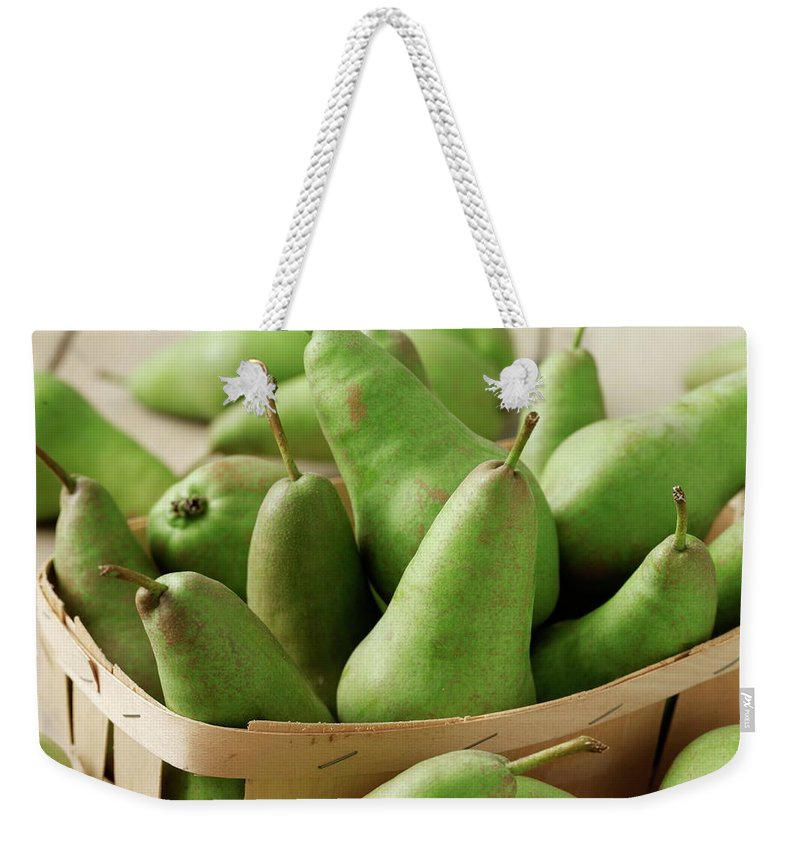 Fruit Carton Weekender Tote Bag featuring the photograph Green Pears In Punnet And Wooden Table by Chris Ted