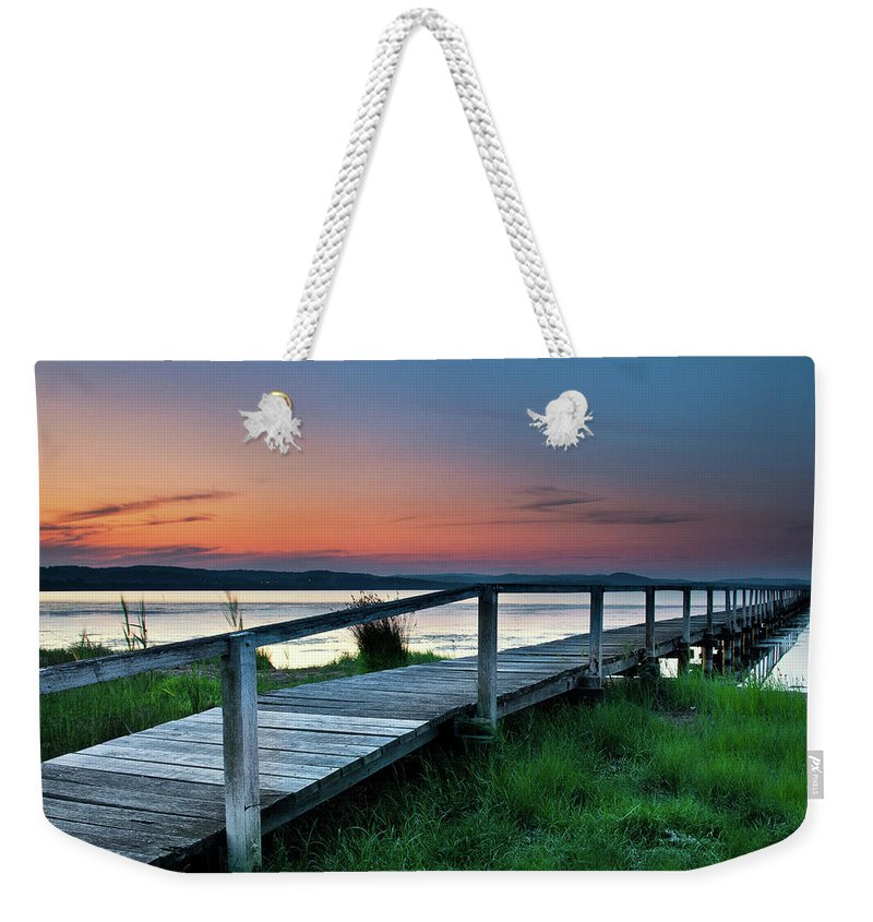 Tranquility Weekender Tote Bag featuring the photograph Greener On The Other Side by Photography By Carlo Olegario