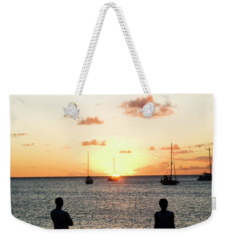Recreational Pursuit Weekender Tote Bag featuring the photograph Group Of Young Friends On Beach At by Jaminwell