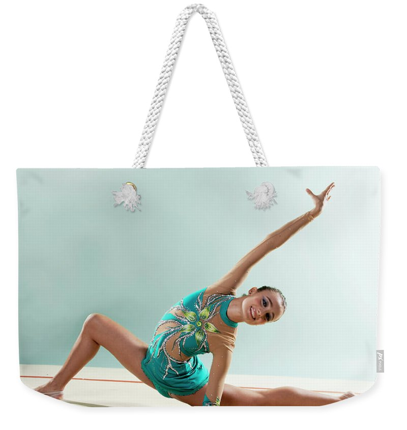 Human Arm Weekender Tote Bag featuring the photograph Gymnast, Smiling, Bending Backwards by Emma Innocenti