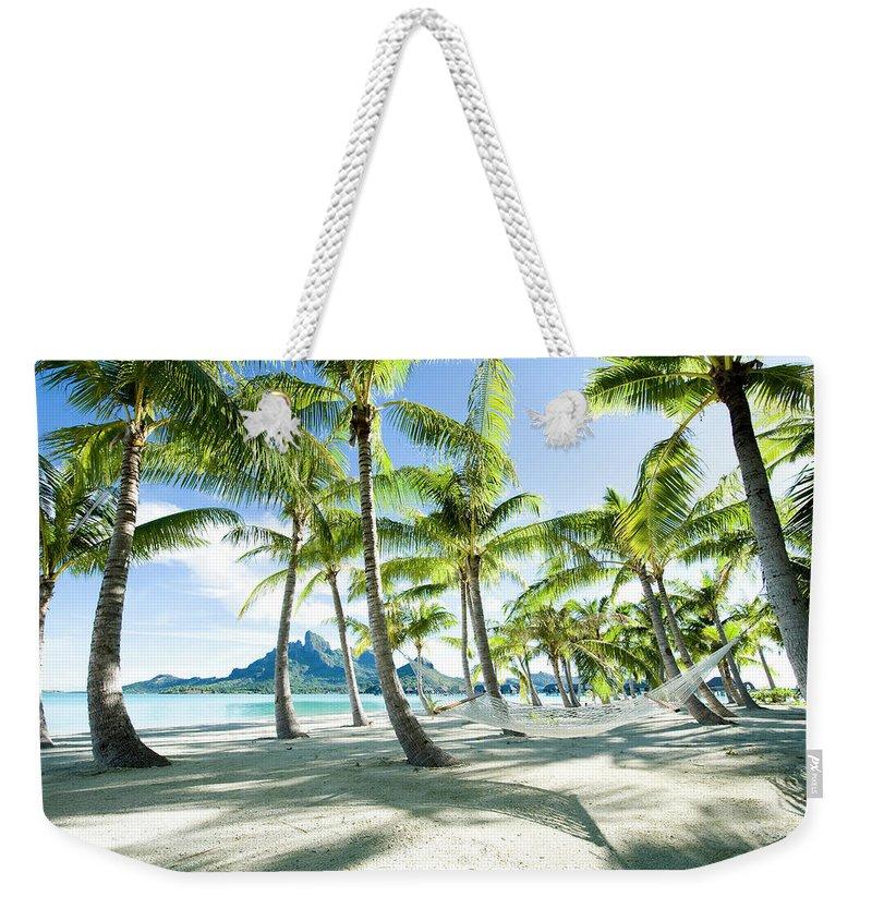 Hanging Weekender Tote Bag featuring the photograph Hammock At Bora Bora, Tahiti by Yusuke Okada/amanaimagesrf