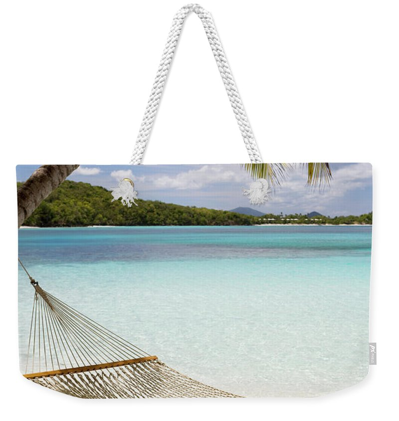 Water's Edge Weekender Tote Bag featuring the photograph Hammock Hung On Palm Trees On A by Cdwheatley