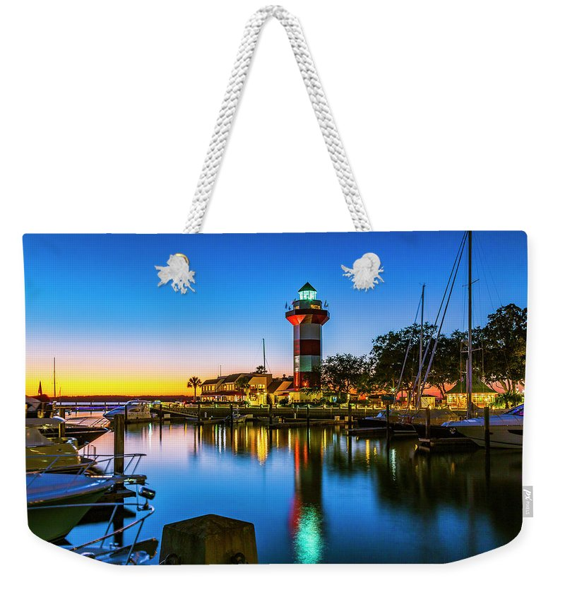 America Weekender Tote Bag featuring the photograph Harbor Town Lighthouse - Blue Hour by ProPeak Photography