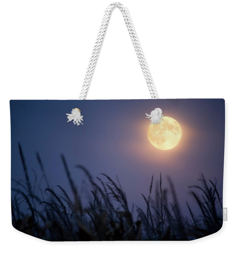 Sky Weekender Tote Bag featuring the photograph Harvest Moon by Jimkruger