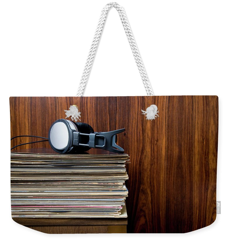 Technology Weekender Tote Bag featuring the photograph Headphones Laying On Stack Of Vinyl by Steven Errico