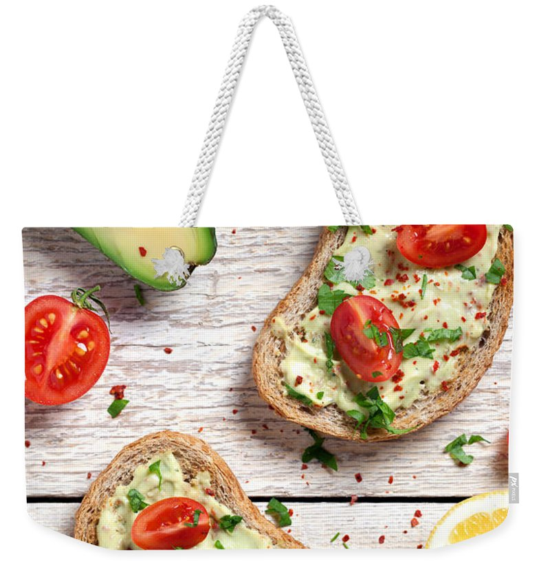 Breakfast Weekender Tote Bag featuring the photograph Healthy Whole Grain Bread With Avocado by Barcin