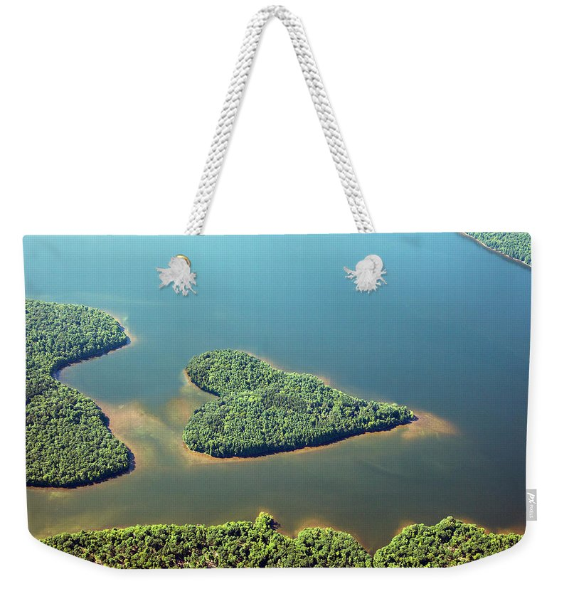 Outdoors Weekender Tote Bag featuring the photograph Heart-shaped Island In Lake by Thomas Jackson