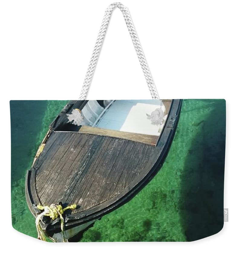 Tranquility Weekender Tote Bag featuring the photograph High Angle View Of Boat Moored On Sea by Iva Saric / Eyeem