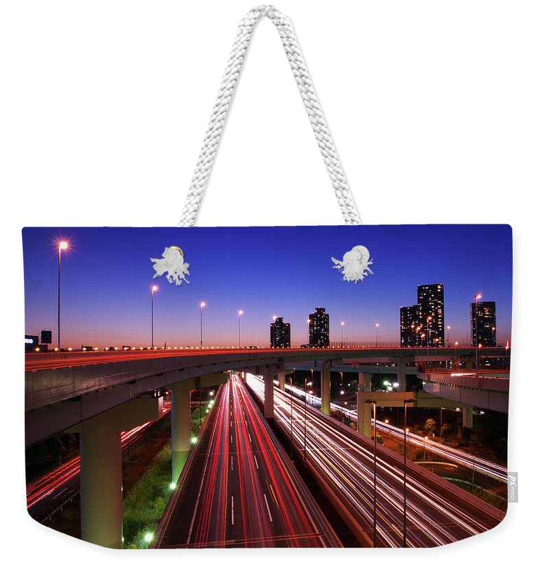 Two Lane Highway Weekender Tote Bag featuring the photograph Highway At Night by Takuya Igarashi