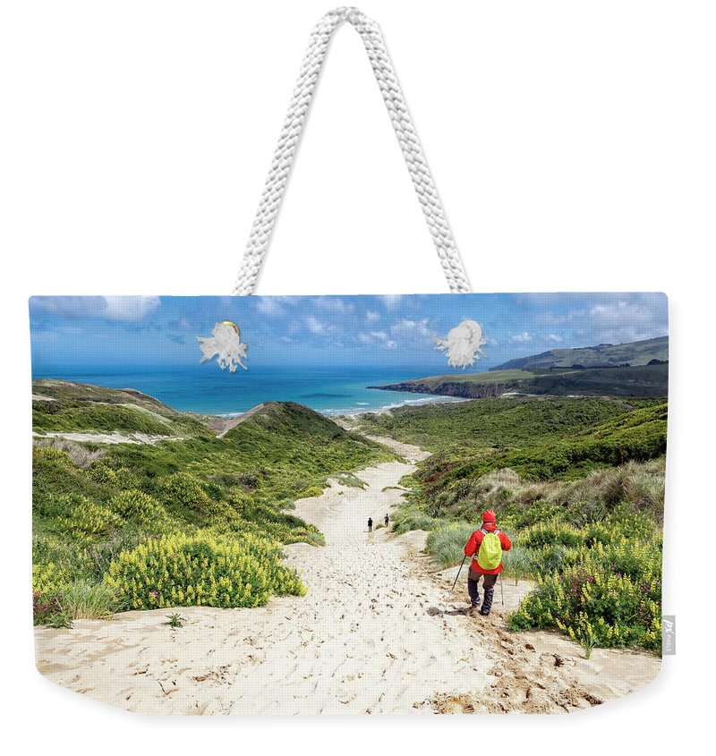 Joan Carroll Weekender Tote Bag featuring the photograph Hiking To Sandfly Bay New Zealand by Joan Carroll