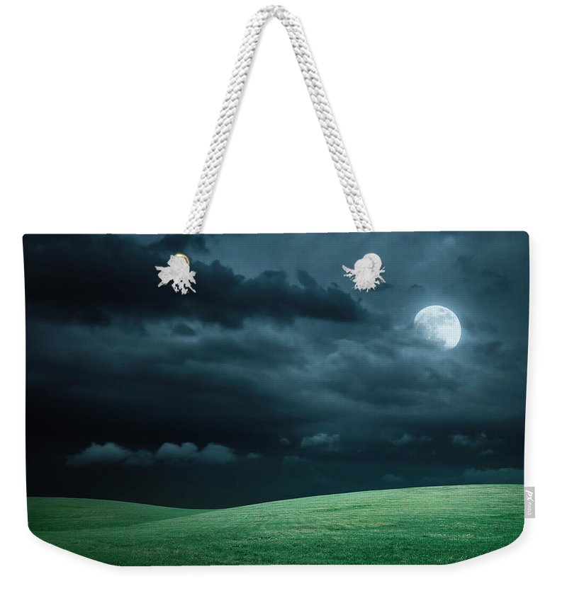 Scenics Weekender Tote Bag featuring the photograph Hilly Meadow At Night With Full Moon by Spooh