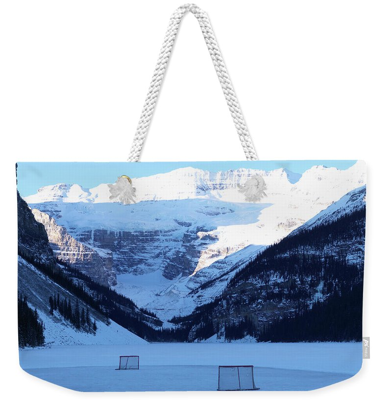 Scenics Weekender Tote Bag featuring the photograph Hockey Net On Frozen Lake by Ascent/pks Media Inc.
