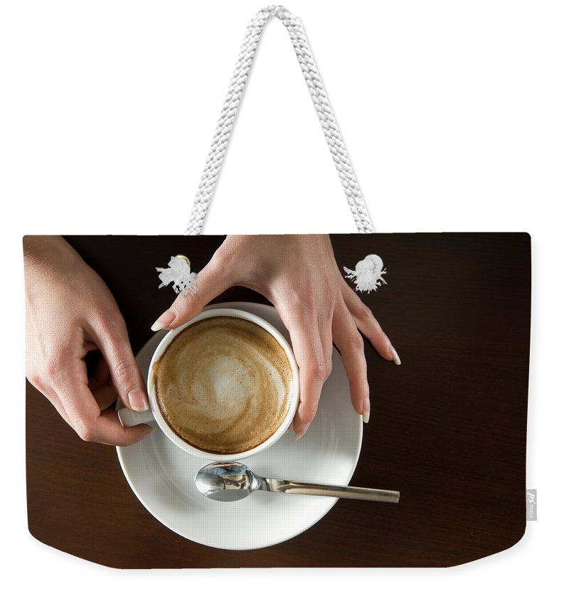 Spoon Weekender Tote Bag featuring the photograph Holding Cappuccino by 1001nights