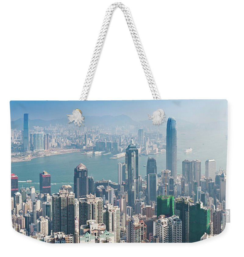 New Territories Weekender Tote Bag featuring the photograph Hong Kong Iconic Skyscraper City by Fotovoyager
