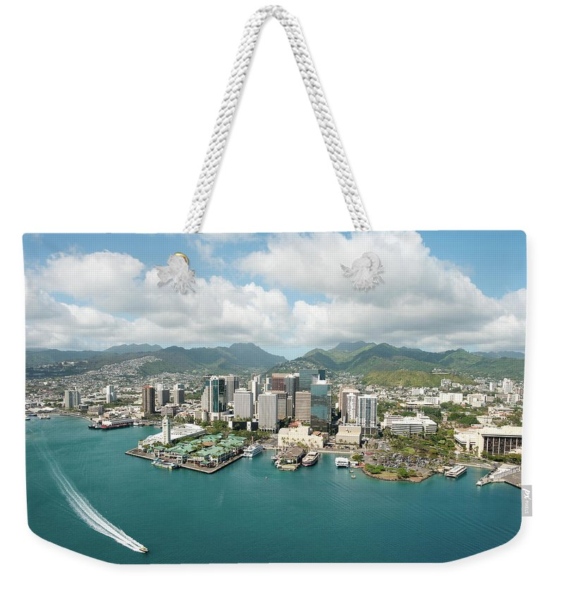 Honolulu Weekender Tote Bag featuring the photograph Honolulu Skyline Shot From A Helicopter by 400tmax