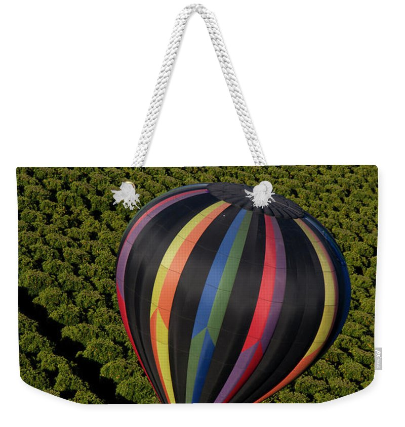 Tranquility Weekender Tote Bag featuring the photograph Hot Air Balloon by Holly Harris
