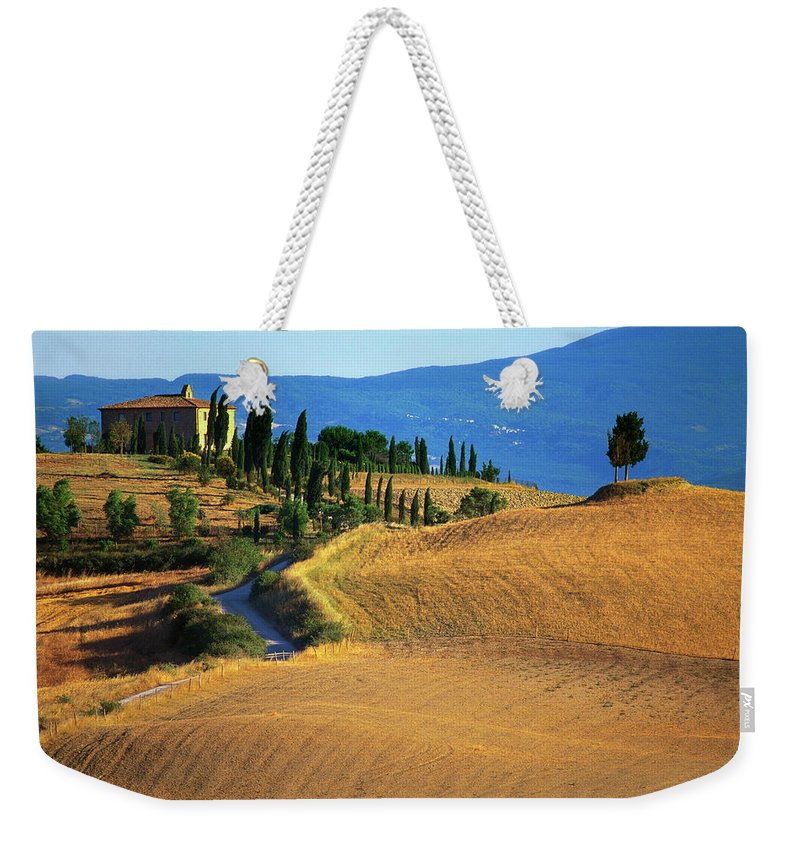 Travel14 Weekender Tote Bag featuring the photograph House In A Field In The Siena by Robertharding