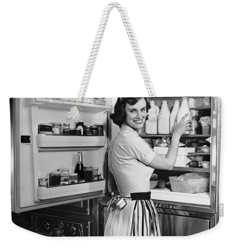 Milk Weekender Tote Bag featuring the photograph House Wife Removing Milk From by George Marks