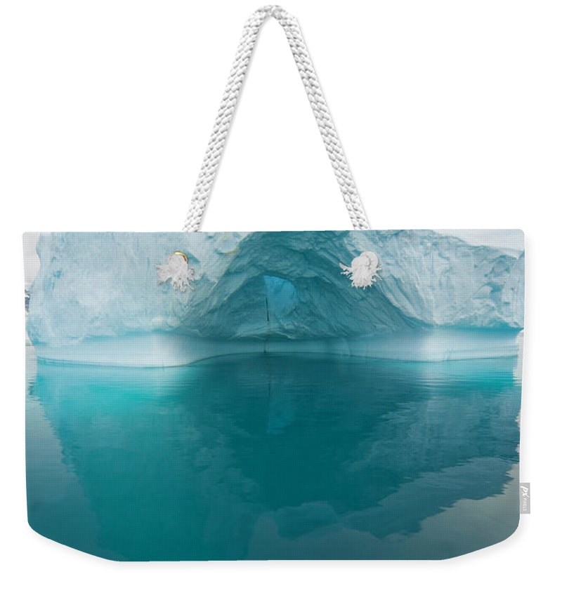 Iceberg Weekender Tote Bag featuring the photograph Iceberg And Reflections, Antarctic by Eastcott Momatiuk