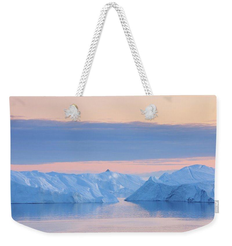 Iceberg Weekender Tote Bag featuring the photograph Iceberg by Raimund Linke