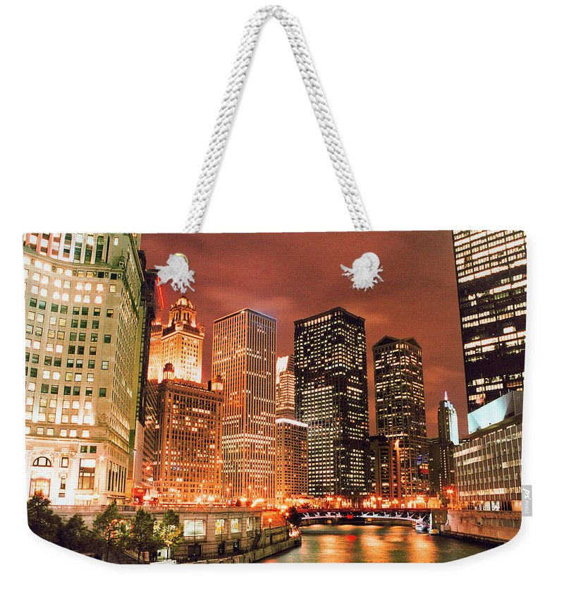 Dawn Weekender Tote Bag featuring the photograph Illuminated Chicago River Skyline At by Vfka