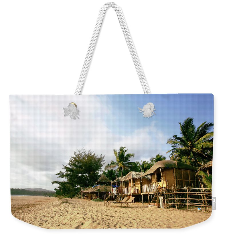 Scenics Weekender Tote Bag featuring the photograph India, Goa, Beach Huts On Agonda Beach by Sydney James