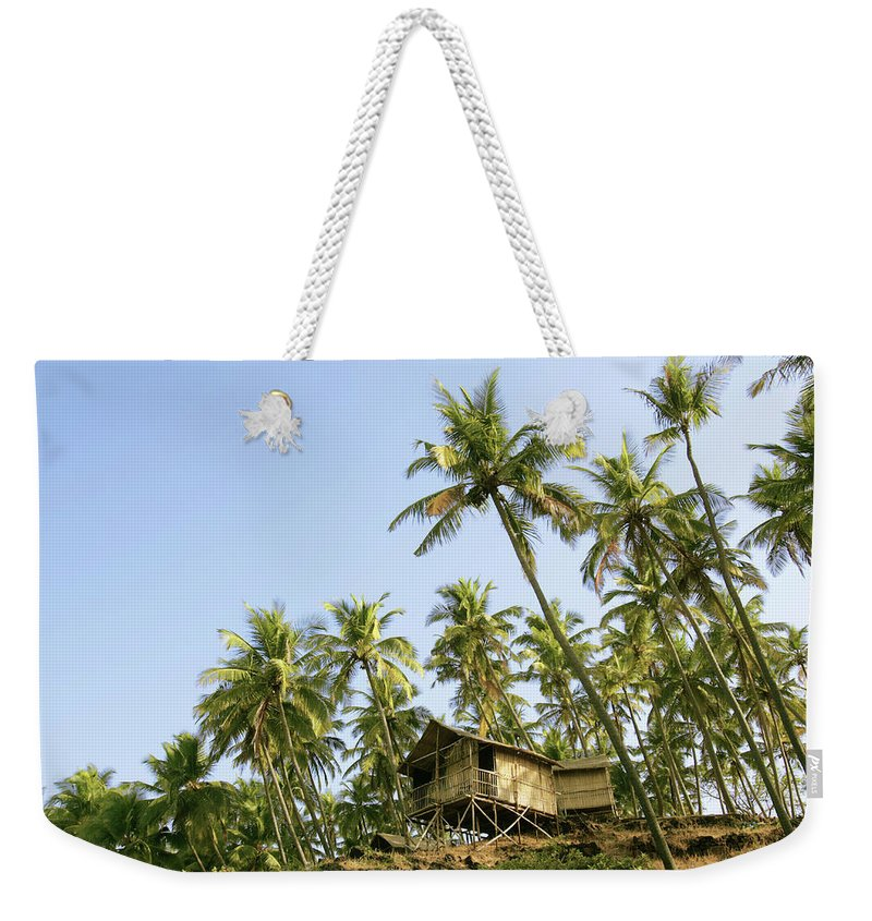 Scenics Weekender Tote Bag featuring the photograph India, Goa, Beach Huts On Palolem by Sydney James