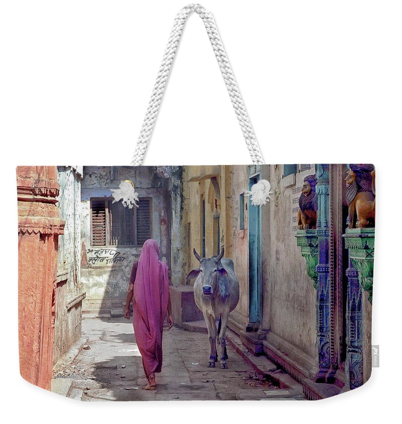 Horned Weekender Tote Bag featuring the photograph India Lady And Cow by Glenn Losack