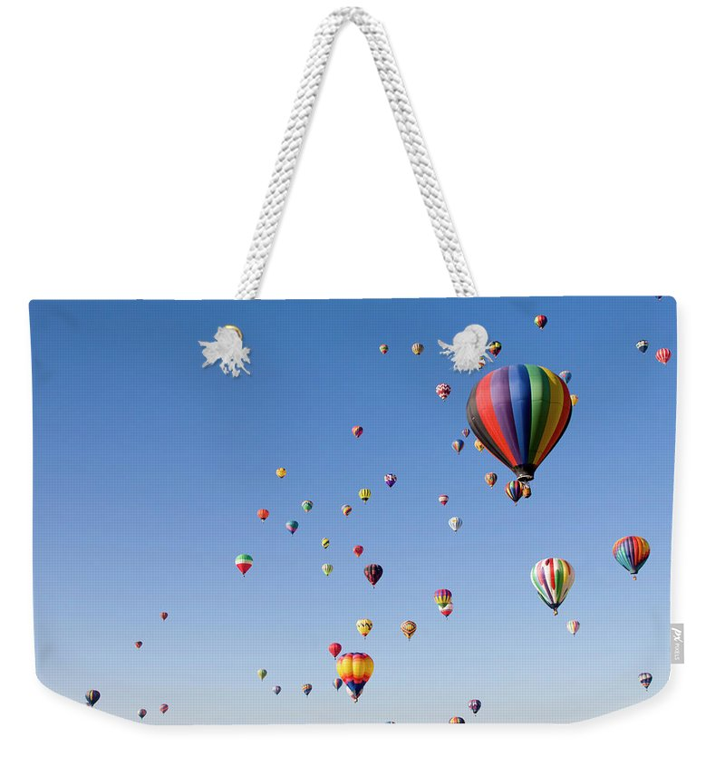 Event Weekender Tote Bag featuring the photograph International Balloon Fiesta by Prmoeller