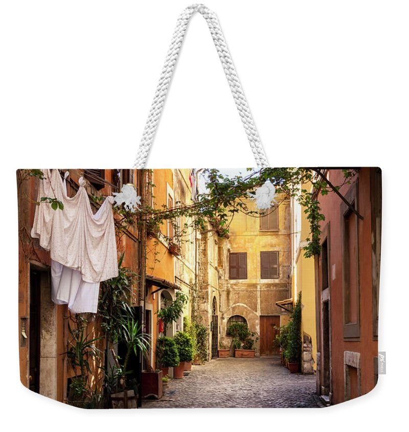 Roman Weekender Tote Bag featuring the photograph Italian Old Town Trastevere In Rome by Spooh