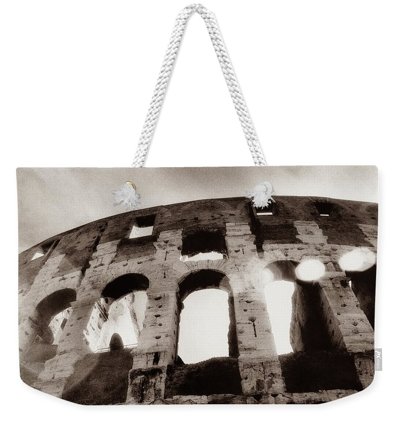 Roman Weekender Tote Bag featuring the photograph Italy, Rome, The Colosseum, Low Angle by Carolyn Bross