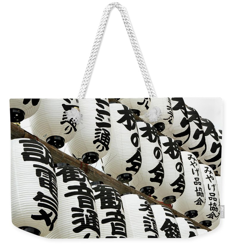 Pole Weekender Tote Bag featuring the photograph Japanese Paper Lanterns In Preparation by Britta Wendland